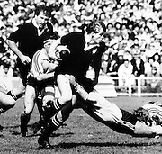 New Zealand vs Australia - Mark Shaw bursts through the Australian defense backed up by Gary Knight. 1986, Rugby archival. Photo: Norman Smith