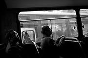Commuters ride a bus in Chongqing.