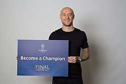 "CARDIFF, WALES - Monday, November 7, 2016: Wales' David Cotterill holds up a board ""Become a Champion"" to encourage people to become volunteers for the 2017 UEFA Champions League Final in Cardiff. (Pic by David Rawcliffe/Propaganda)"