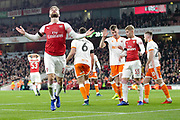 Arsenal defender Shkodran Mustafi (20) cannot believe he missed a chance in front of goal during the EFL Cup 4th round match between Arsenal and Blackpool at the Emirates Stadium, London, England on 31 October 2018.