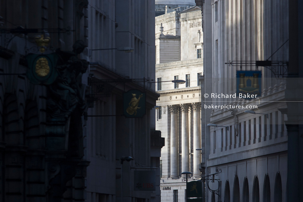 Looking northwards along Lombard Street towards the pillars of the Bank of England in the City of London.