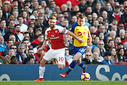 Arsenal defender Shkodran Mustafi (20) battles for possession Southampton midfielder Pierre-Emile Hojbjerg (23) during the Premier League match between Arsenal and Southampton at the Emirates Stadium, London, England on 24 February 2019.