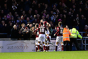 Northampton's players celebrate taking the lead against MK Dons during  the The FA Cup match between Northampton Town and Milton Keynes Dons at Sixfields Stadium, Northampton, England on 9 January 2016. Photo by Dennis Goodwin.