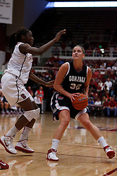 Nov 13, 2011; Stanford CA, USA;  Gonzaga Bulldogs forward Kayla Standish (32) is defended by Stanford Cardinal forward Chiney Ogwumike (left) during the first half at Maples Pavilion.  Stanford defeated Gonzaga 76-61. Mandatory Credit: Jason O. Watson-US PRESSWIRE