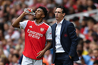 Football - 2019 Emirates Cup - Arsenal vs. Lyon<br /> <br /> Arsenal manager Unai Emery  with Reiss Nelson, at the Emirates Stadium.<br /> <br /> COLORSPORT/ASHLEY WESTERN