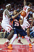 FAYETTEVILLE, AR - DECEMBER 19:  Marshun Newell #25 of the UT Martin Skyhawks is defended by Bobby Portis #10 of the Arkansas Razorbacks at Bud Walton Arena on December 19, 2013 in Fayetteville, Arkansas.  The Razorbacks defeated the Skyhawks 102-56.  (Photo by Wesley Hitt/Getty Images) *** Local Caption *** Marshun Newell; Bobby Portis
