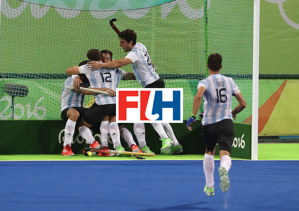 RIO DE JANEIRO, BRAZIL - AUGUST 18:  Agustin Mazzilli of Argentina celebrates with team mates after scoring their fourth goal during the Men's Gold Medal match between Argentina and Belgium on Day 13 of the Rio 2016 Olympic Games held at the Olympic Hockey Centre on August 18, 2016 in Rio de Janeiro, Brazil.  (Photo by David Rogers/Getty Images)