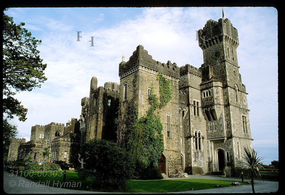 Ashford Castle, an 83-room hotel counted among Ireland's finest, towers skyward at sunset; Cong, Ireland.