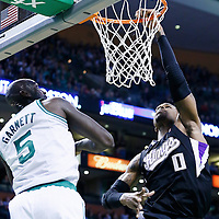 30 January 2013: Sacramento Kings power forward Thomas Robinson (0) misses a dunk over Boston Celtics power forward Kevin Garnett (5) during the Boston Celtics 99-81 victory over the Sacramento Kings at the TD Garden, Boston, Massachusetts, USA.