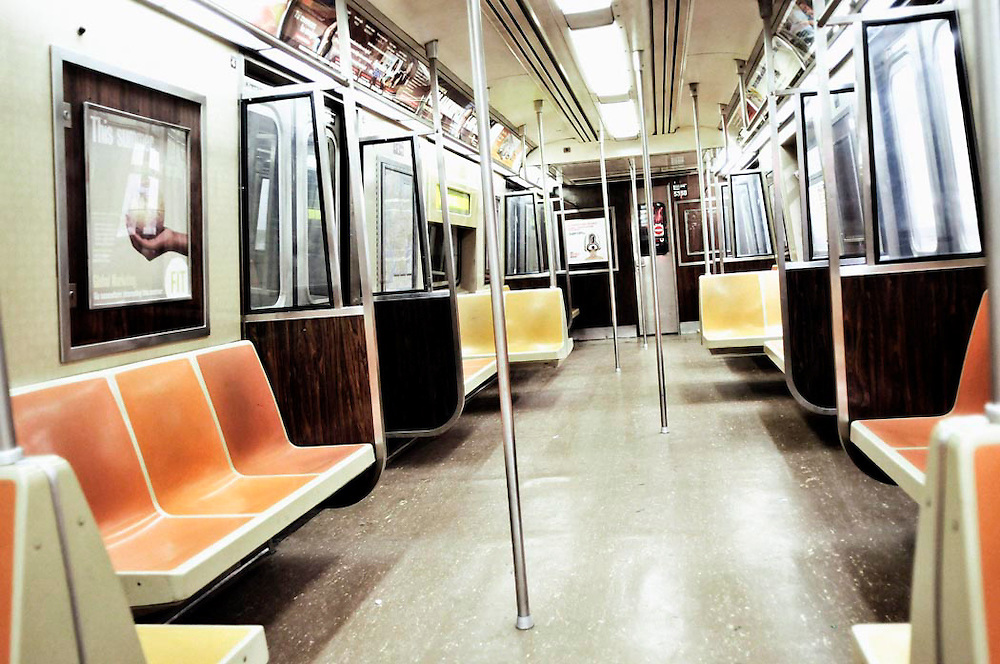 An empty car inside the NYC subway train.