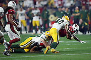 Arizona Cardinals rookie running back David Johnson (31) gets tackled by Green Bay Packers strong safety Morgan Burnett (42) and Green Bay Packers rookie inside linebacker Jake Ryan (47) as he runs for a first quarter gain of 8 yards during the NFL NFC Divisional round playoff football game against the Green Bay Packers on Saturday, Jan. 16, 2016 in Glendale, Ariz. The Cardinals won the game in overtime 26-20. (©Paul Anthony Spinelli)