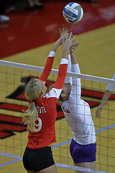 06 November 2010: Mallory Leggett and Ellen Sawin battle at the net during an NCAA volleyball match between the Purple Aces of the University of Evansville and the Illinois State Redbirds at Redbird Arena in Normal Illinois.