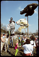 Papier-mache zebra, gator and jaguar heads loom over crowd at Earth Day; Forest Park-St Louis. Missouri