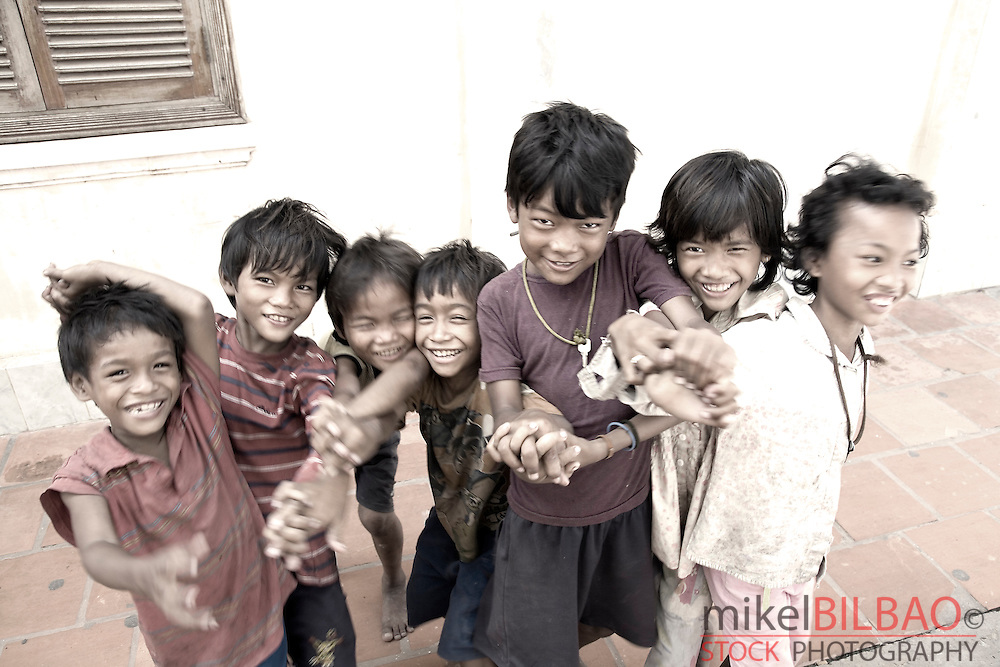young boys playing on the street.<br /> Siem Reap, Cambodia, Asia