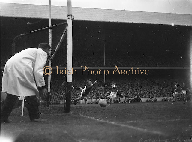 Down goalie E McKay attempts to save shot by Kerry's John Dowling during the All Ireland Senior Gaelic Football Final Kerry v Down in Croke Park on the 22nd September 1960. Down 2-10 Kerry 0-8.
