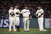 The San Francisco Giants infield hangs during a pitcher change against the Los Angeles Dodgers at AT&T Park in San Francisco, California, on April 24, 2017. (Stan Olszewski/Special to S.F. Examiner)