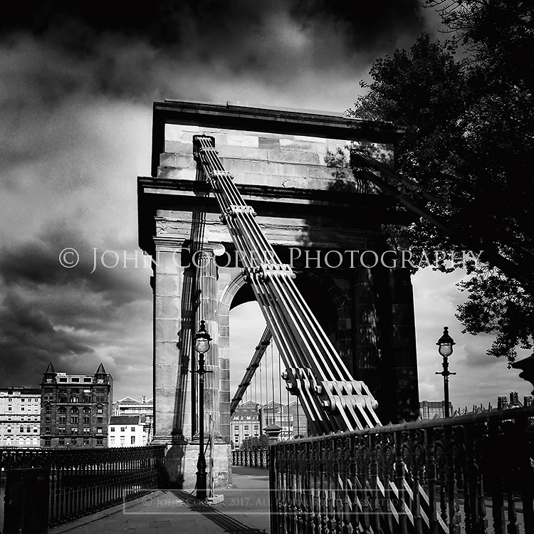 Black and White photograph of River Clyde suspension bridge at Portman Street in Glasgow. Mounted print available to purchase.
