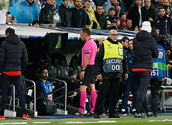 Referee reviews VAR during UEFA Champions League match, groups between Real Madrid and Paris Saint Germain at Santiago Bernabeu Stadium in Madrid, Spain. November, Tuesday 26, 2019. Photo by Manu R.B./AlterPhotos/ABACAPRESS.COM