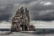 Fairfull rock with an arch in the ocean
