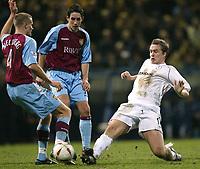 Photo. Aidan Ellis.<br />Bolton Wanderers v Aston Villa.<br />Carling Cup Semi Final 1st Leg.<br />21/01/2004<br />Bolton's Kevin Davis and Villa's Olef Mellberg