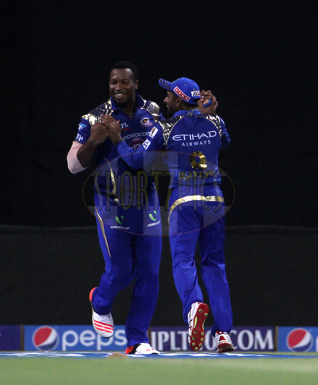 Mumbai Indians player Kieron Pollard celebrates after taking the catch of Sunrisers Hyderabad player Dale Steyn during match 23 of the Pepsi IPL 2015 (Indian Premier League) between The Mumbai Indians and The Sunrisers Hyderabad held at the Wankhede Stadium in Mumbai India on the 25th April 2015.<br /> <br /> Photo by:  Vipin Pawar / SPORTZPICS / IPL