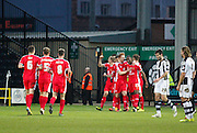 MK Dons celebrate the opening goal during the Sky Bet League 1 match between Notts County and Milton Keynes Dons at Meadow Lane, Nottingham, England on 26 December 2014. Photo by Jodie Minter.