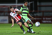 Forest Green Rovers Reece Brown(10) is tackled by Cheltenham Town's Alex Davey(29) during the EFL Trophy match between Cheltenham Town and Forest Green Rovers at Whaddon Road, Cheltenham, England on 3 October 2017. Photo by Shane Healey.