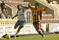 Photo: Aidan Ellis.<br /> Bradford City v Swindon Town. Coca Cola League 1. 11/02/2006.<br /> Swindon's Ricky Shakes is challenged by Bradford's Bobby Peta