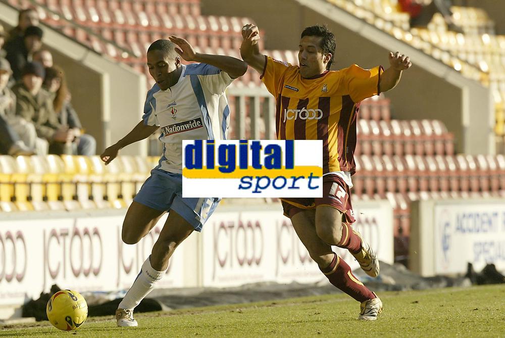 Photo: Aidan Ellis.<br /> Bradford City v Swindon Town. Coca Cola League 1. 11/02/2006.<br /> Swindon's Ricky Shakes is challenged by Bradford's Bobby Peta