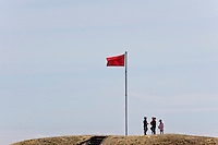 Children at Fort Rodd Hill, a national historic site, climb to the top of one of the old gun placements and metaphorically represent the childhood game of king of the castle.  Fort Rodd Hill national historic site, Colwood, Victoria, Southern Vancouver Island, British Columbia, Canada.
