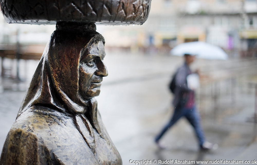 Kumica Barica. Sculpture of a peasant woman at the entrance to Dolac market, on a rainly day in Zagreb, Croatia