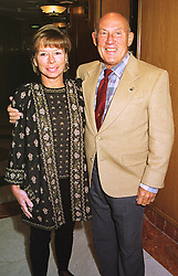 MR & MRS STIRLING MOSS, he is the racing driver, at a luncheon in London on 31st January 1999.MNR 37