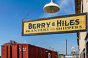 Planters and shippers' business signs that hang along the oyster docks of Bayshore Center at Bivalve.