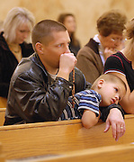 A father and son at a prayer service in Green Bay. (Sam Lucero photo)