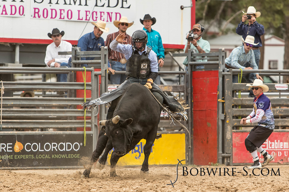 Bull rider Jess Davison rides Summit Pro Rodeo's Touch N Go during the third performance of the Elizabeth Stampede on Sunday, June 3, 2018.