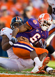 November 21, 2009; Clemson, SC, USA; Clemson Tigers wide receiver Jacoby Ford (6) is tackled by Virginia Cavaliers linebacker Darren Childs (49) during the second quarter at Memorial Stadium.  Clemson defeated Virginia 34-21.