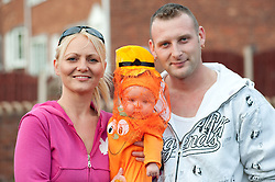 Guinness Northern Counties Housing Associations Godley Street  Scheme Hold a Halloween Street Party.Mum Kerry Pugh, baby Sky Rose Pugh and Dad Wayne Pugh.30 October 2010 .Images © Paul David Drabble
