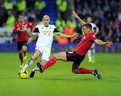 Cardiff City's Ben Turner tackles Swansea City's Jonjo Shelvey - Photo mandatory by-line: Joe Meredith/JMP - Tel: Mobile: 07966 386802 03/11/2013 - SPORT - FOOTBALL - The Cardiff City Stadium - Cardiff - Cardiff City v Swansea City - Barclays Premier League