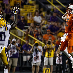 Sep 23, 2017; Baton Rouge, LA, USA; Syracuse Orange quarterback Eric Dungey (2) jumps to throw a pass over LSU Tigers linebacker Devin White (40) during the fourth quarter of a game at Tiger Stadium. LSU defeated Syracuse 35-26. Mandatory Credit: Derick E. Hingle-USA TODAY Sports