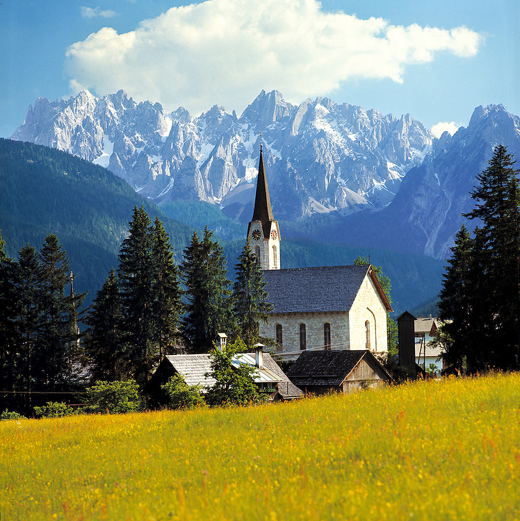 The sharp spire of the church at Gosau, in the Dachstein Alps, Austria, mimicks the crags of the background mountains.