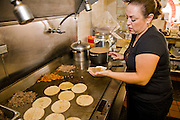 Lourdes Alvarez prepares tacos at her Mexican Restaurant, El Coyote in the suburb of Alsip, Chicago.  (Lourdes Alvarez is featured in the book What I Eat;  Around the World in 80 Diets.)   MODEL RELEASED.