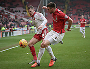 Paul Coutts (Sheffield United) and Chris Stokes (Coventry City) during the Sky Bet League 1 match between Sheffield Utd and Coventry City at Bramall Lane, Sheffield, England on 13 December 2015. Photo by Mark P Doherty.