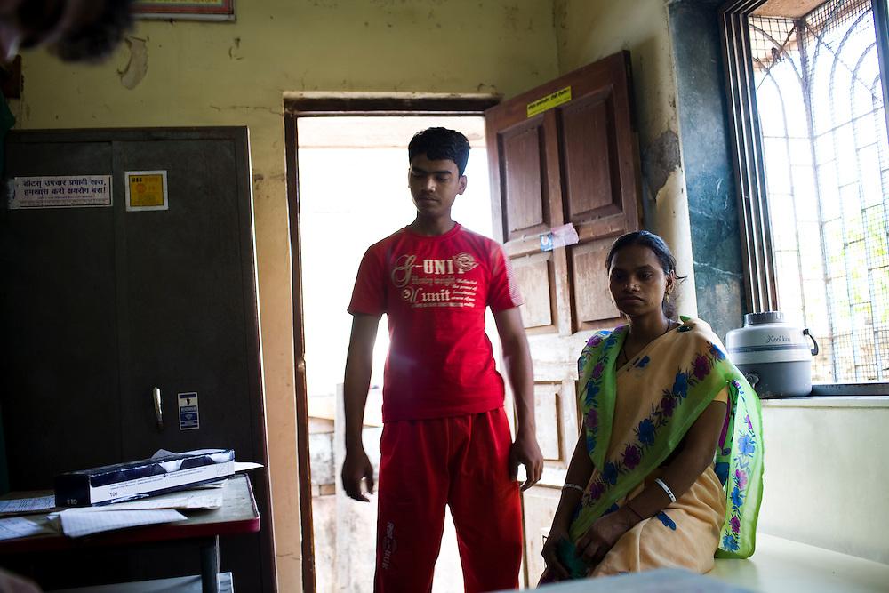 Mulchanel Singardiya and his sister,Santoshi Fulwariya, wait to get medicine for Santoshi at the Thakkar Bappa DOTS Center.