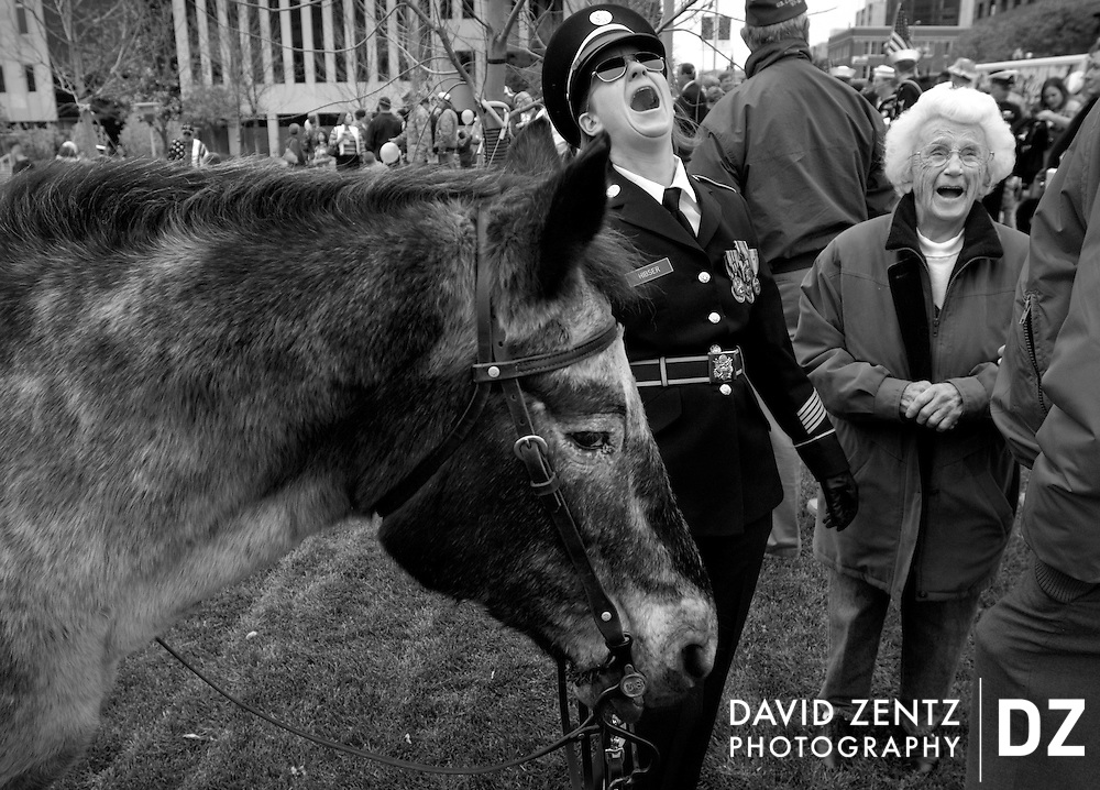 Wendy Hibser with the Illinois Army National Guard laughs with her 90-year-old grandmother Virginia Davis as she holds on to her 30-year-old Appaloosa horse, Dusty, prior to the start of a Veterans Day ceremony in Peoria, Ill.