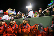 10/23/13 — BOSTON — Fenway Park groundskeepers wait to clean the field during Game 1 of the World Series on Oct. 23, 2013.