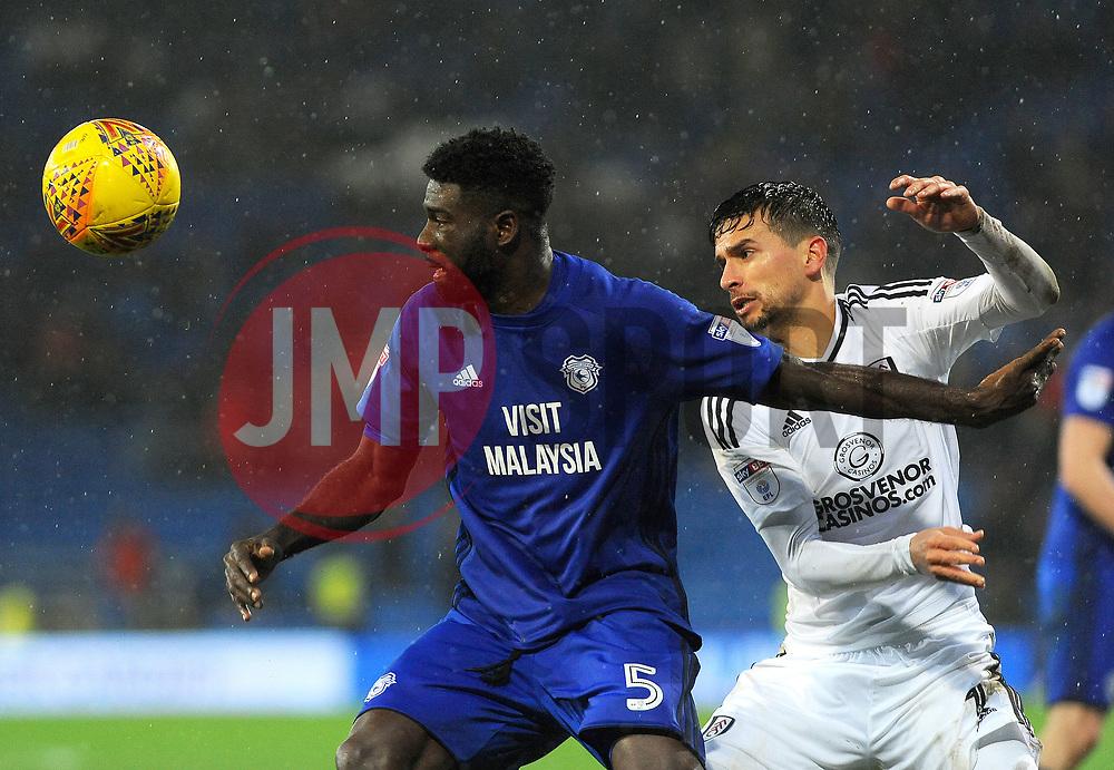 Bruno Ecuele Manga of Cardiff City battles with Marcus Bettinelli of Fulham for the highball  - Mandatory by-line: Nizaam Jones/JMP- 26/12/2017 -  FOOTBALL - Cardiff City Stadium - Cardiff, Wales -  Cardiff City v Fulham - Sky Bet Championship