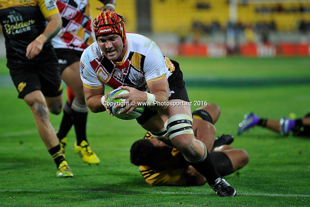 Steven Sykes captain of the Southern Kings scores a try as he is tackled by Chris Eves of the Hurricanes during the Hurricanes vs Kings Super Rugby  match at the Westpac Stadium in Wellington on Friday the 25th of March 2016. Copyright Photo by Marty Melville / www.Photosport.nz