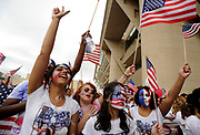 (from left) UT Arlington student Tahj Walker, Eastfield College student Julie Bento, Shaun McNary , Elizabeth Bento and Priscilla Bento show their support after pledging allegiance in front of Dallas City Hall during the MegaMarch for Immigration Reform,  May 01, 2010