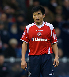 WEST BROMWICH, ENGLAND - Saturday, December 15, 2007: Charlton's Zhi Zheng looks dejected as he watches his side lose 4-2 to West Bromwich Albion during the League Championship match at the Hawthorns. (Photo by David Rawcliffe/Propaganda)