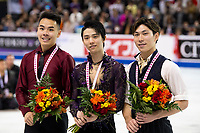 KELOWNA, BC - OCTOBER 27: Mens long program gold medalist, Japanese skater Yuzuru Hanyu (c), silver medalist, Canadian figure skater Nam Nguyen (l) and bronze medalist, Japanese skater Keiji Tanaka (r) stand on the ice at Prospera Place on October 27, 2019 in Kelowna, Canada. (Photo by Marissa Baecker/Shoot the Breeze)